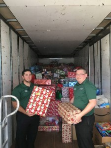 AMS Fort Myers local movers Ray Wood (left) and Charlie Perez (right) helped bring the holiday spirit to children supported by The Children's Network of Southwest Florida's Operation Santa.